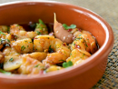 Prawns pil pil (Ornina)Serves: 4Ingredients:500g medium-sized prawns100g olive oil2 cloves of garlic, thinly sliced2 small dried chilies1 tsp of paprika Fresh chopped parsleySaltMethod:1 Clean the prawns and place in a heat-proof clay cooking dish (a tagine could be used).2 Pour the olive oil over the prawns and then add the rest of the ingredients.3 Place the clay dish over a medium heat and cook the prawns through.4 Remove from the heat and serve in the same dish with some bread on the side. For more spice add some cayenne pepper.