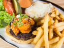 Tuck into the Atomic Shrimp Burger at Black Tap in Yas Mall, Yas Island