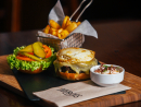 HeroesThe casual pub has come up with two creations for Showdown Week. The barbecue pulled-beef burger features shredded slow-cooked beef with barbecue sauce and pickled gherkin, while the towering Heroes burger is laden with a fried egg, beef bacon, salad and coleslaw. If you finish that you really will be a hero.Dhs80 (burger). Crowne Plaza Abu Dhabi, Sheikh Hamdan Bin Mohammed Street, Al Markaziyah (02 418 2495).