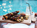 Enjoy a poolside barbecueAbu Dhabi Golf Club is helping us to make the most of our beautiful weekends in the capital. It has introduced a Lazy Grillin' pool barbecue, and it sounds all kinds of awesome.Taking place from 1pm until 4pm every Saturday, the deal includes pool access, food and soft drinks for Dhs190 or Dhs220 with house beverages. Kids will love the inflatables, bouncy castle and giant water slide, while the barbecued dishes include steaks, lamb skewers, peri-peri chicken and Thai prawns. There's also pastas, stews, salads, noodles and more to munch on, and the drinks package covers cold hops, grapes and a range of premium beverages. Sunbathing and eating all Saturday afternoon sounds pretty ideal to us.Dhs190 (soft drinks), Dhs220 (house beverages). Sat 1pm-4pm. Abu Dhabi Golf Club, Khalifa City A (02 885 3555).