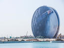 Aldar HQShaped like a giant coin, Aldar HQ is instantly recognisable and one of the most impressive buildings we've ever seen, never mind just in Abu Dhabi. The building was even previously voted 'Best Futuristic Design' by the Building Exchange Conference. The 23-storey, 110-metre-high structure was also named by international building organisation Emporis as 'One of the World's Most Dazzling Corporate Offices' for its innovative design, visual impact and function. We couldn't agree more, it's pretty cool.