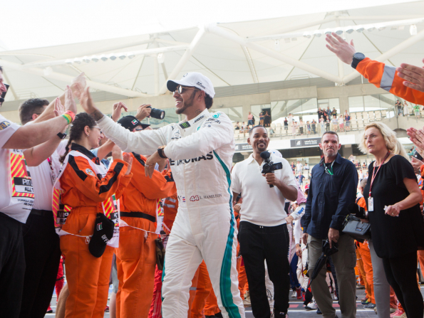 Lewis Hamilton wins the Abu Dhabi Grand Prix - with Will Smith waving the chequered flag