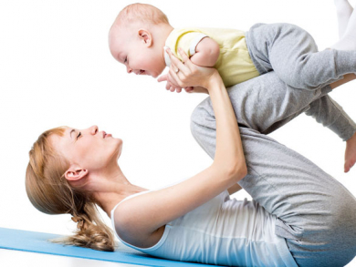 Mother and baby stretch and bond