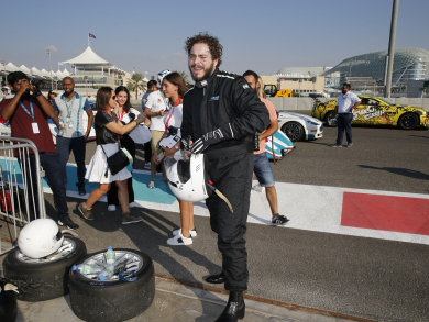 Pictured: Post Malone goes for a ride around Yas Marina Circuit