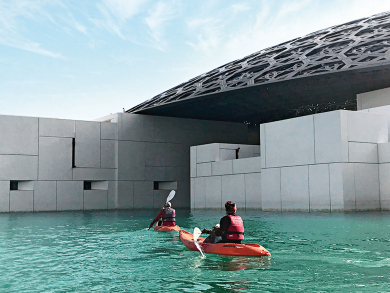 You can go on a sunrise kayak tour around Louvre Abu Dhabi
