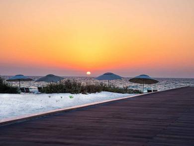 Dine on Saadiyat Beach with Boardwalk Sunsets